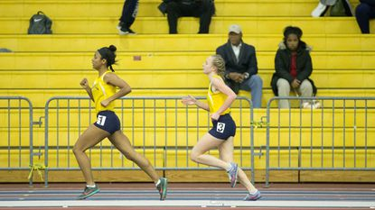 River Hill's Faith Meininger, right, catches up to teammate Jasmine Tiamfook while they compete in the 1600-meter run during the Howard County indoor track and field championships at the Prince George's Sports & Learning Complex on Jan. 16.