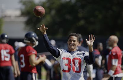 Houston Texans first-round draft pick Kevin Johnson throws a football during an NFL practice Monday, June 1, 2015, in Houston.