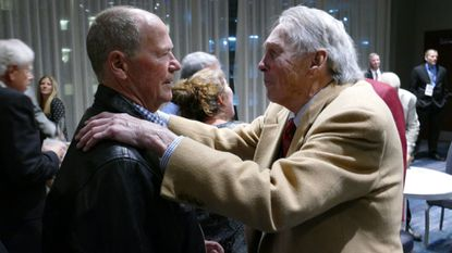 Former Orioles second baseman Rich Dauer, left, is greeted by hall-of-fame Brooks Robinson during a gala at the Renaissance Harborplace Hotel in Baltimore to celebrate the team's 1983 World Series championship.