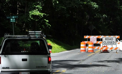 A vehicle turns onto Rocks Chrome Hill Road to follow the detour around the section of Route 24, Rocks Road, that is closed for construction. Detour signs have been placed along several roads in the area to help drivers navigate their way around the area between Rocks Chrome Hill and St. Clair Bridge roads.