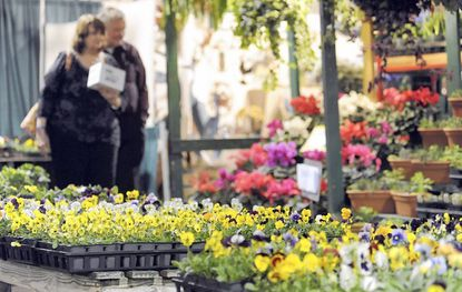 Visitors walk among flowers at last year's Maryland Home and Garden Show in Timonium. This year's show begins March 3.