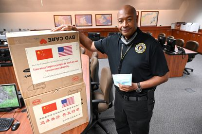 Office of Emergency Management Director Kevin Simmons with a couple boxes of masks, just a small portion of 40,000 medical grade face masks dontaed to Annapolis from the municipal government of Changsha, China.