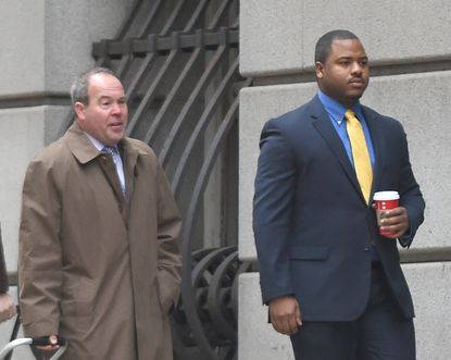 Officer William Porter, right, arrives Monday at the courthouse with his attorney, Joseph Murtha, at the start of the first day of the firsttrial of a Baltimore police officer in Freddie Gray's death.