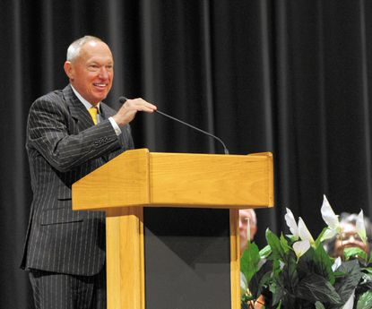 Builder developer Clark Turner, shown speaking during his 2013 induction to the Havre de Grace High School Hall of Fame, has filed for bankruptcy along with one of his companies.