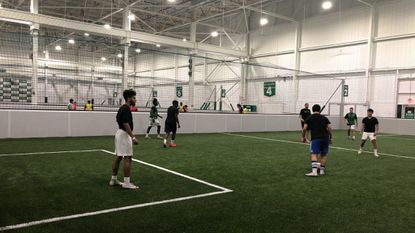 """Ten soccer players compete in """"five-a-side"""" soccer in June at an open field night at Sofive Soccer Centers, a new indoor facility in Columbia."""