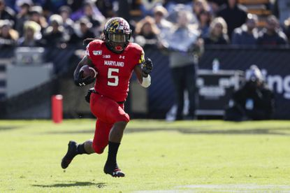 Maryland running back Anthony McFarland Jr. (5) runs against Purdue during the first half in West Lafayette, Ind., Saturday. McFarland was limited against the Boilermakers because of an ankle injury.