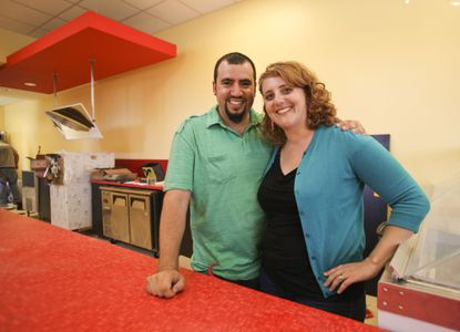 David and Laura Alima stand behind a dipping cabinet at The Charmery, shortly before its summer 2013 opening.