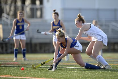 Liberty's Caitlynn Szarko and Manchester Valley's Jessie Bare vie for the ball during the second half of the Lions' 6-0 win over the Mavericks at Western Regional Park in Woodbine Monday, March 8, 2021.