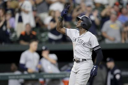 New York Yankees' Cameron Maybin reacts after hitting a solo home run off Baltimore Orioles relief pitcher David Hess during the ninth inning Tuesday.