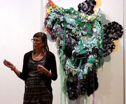 Amy Boone-McCreesh talks about her art during her opening at Rice Gallery at McDaniel College in Westminster Tuesday.