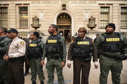Sheriff's deputies surrounded the courthouse after scuffles with protesters following the verdict of a mistrial in the Freddie Gray case.