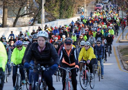 Hundreds of cyclists ride on on University Parkway on a memorial ride for cyclist Tom Palermo.