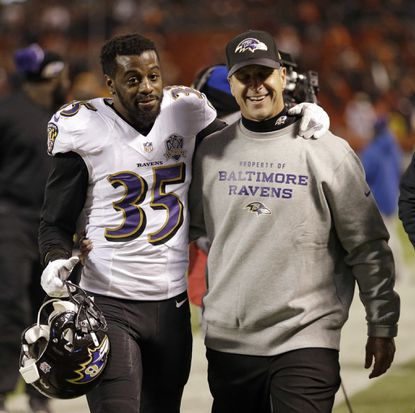 Ravens head coach John Harbaugh, right, and Shareece Wright walk off the field after the Ravens defeated the Cleveland Browns 33-27 in an NFL football game, Monday, Nov. 30, 2015, in Cleveland.