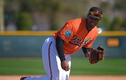 Orioles pitcher Mychal Givens (60) participates in fielding drills during spring trainingat the Ed Smith Stadium complex on Feb. 20, 2016.