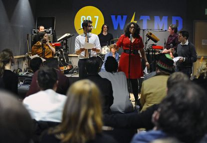 """In 2019, """"Baltimore Hit Parade Live,"""" hosted by Sam Sessa (right) at WTMD's Towson studio, featured a performance by Single Carrot Theatre."""