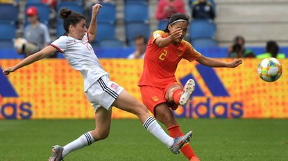 Spain forward Lucia Garcia, left, battles with China defender Shanshan Liu during a Women's World Cup group play match in France on Monday.