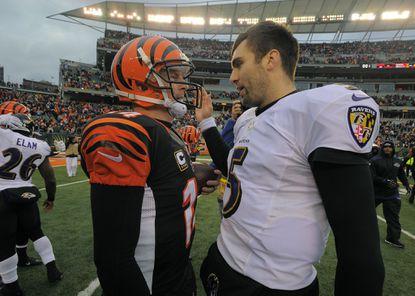 Cincinnati Bengals quarterback Andy Dalton (14) is congratulated by Ravens quarterback Joe Flacco (5) at the expiration of the fourth quarter at Paul Brown Stadium on Sunday, Dec. 29, 2013.