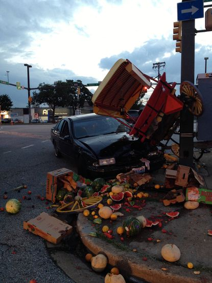 A Chevrolet Impala crashed into an arabber carrying produce Thursday evening near M&T Bank Stadium in Baltimore.