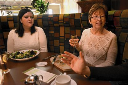 """Lauren McCloskey, left, facilitator for the Howard County Library's Speakeasy book discussion group, with Janis Johnson of Columbia, right, at Seasons 52 restaurant, where they were discussing """"The Strangler Vine,"""" by M.J. Carter. Johnson joined the group when it started about one and a half years ago."""