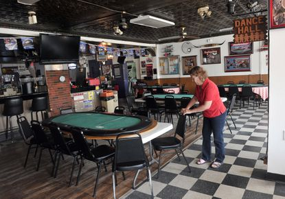 Debbie Hurd, bartender and vice president of Pop's Tavern, says business is not good after the layoffs at the nearby Sparrows Point steel mill.