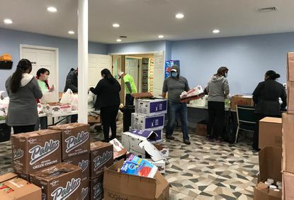 """Amigos of Baltimore County has been holding community food drives such as this one with 4MyCiTy, a regional nonprofit """"food rescue"""" organization that distributes leftover food from hotels and restaurants to local community kitchens and shelters."""