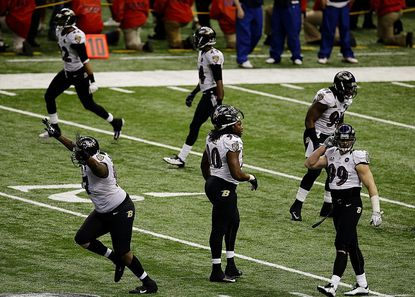 Baltimore Ravens defensive end Arthur Jones (97) celebrates after the San Francisco 49ers failed to score on fourth-and-goal late in the fourth quarter of the NFL Super Bowl XLVII football game, Sunday, Feb. 3, 2013, in New Orleans. (AP Photo/Gerald Herbert)
