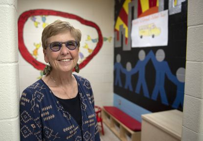 In this Thursday, Sept. 12, 2019 photo, Patricia O'Connor poses for a picture inside a space decorated for children visiting incarcerated family members at the Frederick County Adult Detention Center in Frederick, Md. (Graham Cullen/The Frederick News-Post via AP)