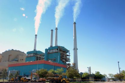Smoke rises from the Colstrip Steam Electric Station, a coal burning power plant in in Colstrip, Mont.