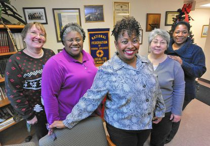 Lisa G. Foust, center, president of NFFE-IAMAW Local 178, based at Aberdeen Proving Ground, with fellow union members from left, Mary Theresa Nipwoda, Dawn Minor, Elizabeth Pittaluga and Inez Tyson are glad for the extra day off.