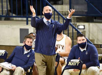 Navy coach Ed DeChellis in the first half of a game against the George Washington University Colonials Wednesday November 25, 2020 at Alumni Hall in Annapolis. Note his mask does not cover his nose.