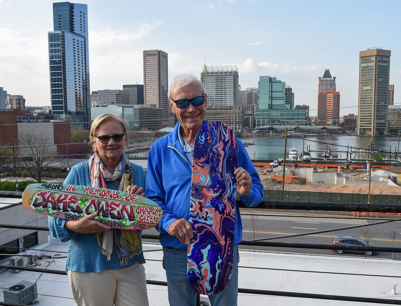 Cindy Conklin and her husband, Bob Merbler, display some of the skateboard decks up for auction at their home on Wednesday, April 7, 2021; the proceeds from the art sales will go to help fund the completion of Jake's Skate Park at Rash Field.