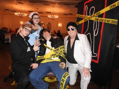 """David Eyring, Delanie Blomquist and Bill DeBrason with a """"victim"""" at a Whodunnit for Hire murder mystery."""