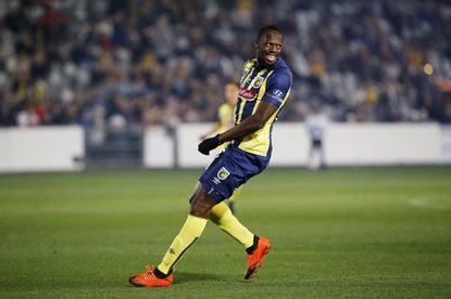 Usain Bolt playing in an exhibition match with the Central Coast Mariners in Australia.