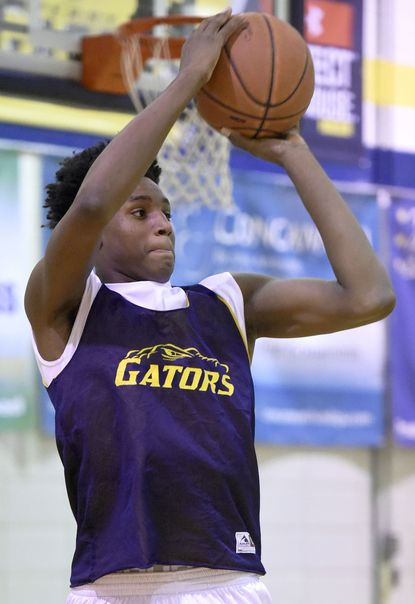 Perry Hall junior Anthony Higgs shoots during high school basketball practice.