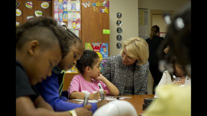 Secretary of Education Betsy DeVos interacts with a first grader at Frank Hebron-Harman Elementary School in Hanover during a guided reading exercise Thursday.