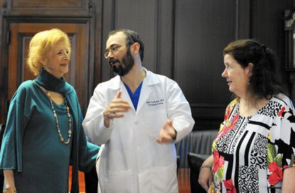 Michelle Martin (left) received a liver from Betty Dzielski (right), who was a recipient of another liver. Dr. John LaMattina (center) was one of the transplant doctors at the University of Maryland Medical Center.
