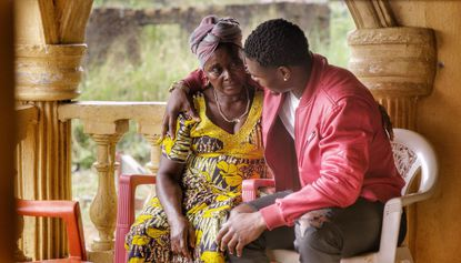 Maryland defensive end Melvin Keihn (Gilman) reunites with his mother, Satta, and family in Liberia from June 30 to July 9.