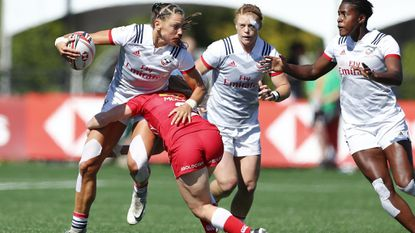 Abby Gustaitis, left, carries the ball during a World Rugby Women's Sevens Series game in Langford, England, on May 13, 2018.