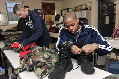 Lance Cpl. Jeremy Holmes of Havre de Grace, left, and Lance Cpl. Curt Moore, of Glenn Dale, two of five Young Marines heading to Hawaii to take part in the 70th anniversary of Pearl Harbor attacks, pack their uniforms. The Kennedy Krieger High School students are the only unit in the nation composed of all special needs students who are based at a special education school.