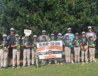 The 10-year old Hickory Hornets are front row, from left, Brayden Sobieralski, Luke Kreiner, Kiernan Deremeik, Mike Griffin Jr., Ryan Bonitz, Peyton DeCourcey, Ty Deal, Conner Vecchioni, Enzo Pobletts, Henry Buyse, Aidan Thiebaud. Back row, row from left, coaches George Sobieralski, Bob Bonitz, Jerry Vecchioni and Tom Thiebaud.