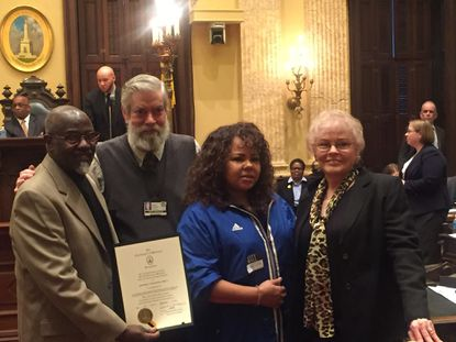 """Couple John Billy (far left) and Shirley Billy (far right) were honored by City Councilman Robert W. Curran during Monday's City Council meeting. John Billy's song """"F.L.A.V.O.R. - The Civil Rights Love Song"""" was presented for consideration as the official Baltimore civil rights love song. Their daughter Terry Billy was also in attendance."""