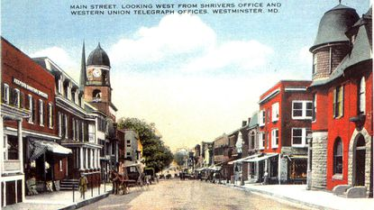 An old family postcard shows the intersection of Main Street and Longwell Avenue at around 1920 when Mayor Koontz was in office.