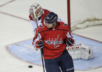 Capitals center Nic Dowd celebrates his second-period goal that proved to be the difference in Washington's 2-1 win over Montreal at Capital One Arena on Thursday night. The victory secured a Metropolitan Division title for the Capitals. MUST CREDIT: Washington Post photo by Toni L. Sandys ** Usable by LA, BS, CT, DP, FL, HC, MC, OS, SD, CGT and CCT **