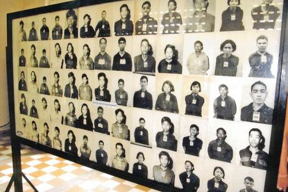 Photographs of some of the estimated 14,000 to 20,000 prisoners killed by the Khymer Rouge are exhibited at the Cambodia Genocide Museum, which occupies the former Tuol Sleng Prison in Phnem Penh, Cambodia. The photographs were taken by the jailers at the prison.