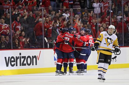Nicklas Backstrom #19 of the Washington Capitals celebrates his goal with teammates against the Pittsburgh Penguins during the first period at Verizon Center on November 16, 2016, in Washington.