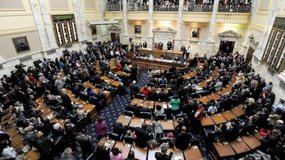 Then Gov.-elect Larry Hogan gives remarks to the Maryland House of Delegates as state House Speaker Michael Busch watches. The Maryland General Assembly opens its 2019 session Wednesday at the State House in Annapolis.
