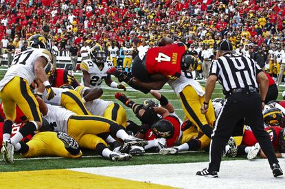 Maryland Terrapins running back Wes Brown (4) leaps into the end zone for a fourth quarter touchdown against the Iowa Hawkeyes at Byrd Stadium in 2014.