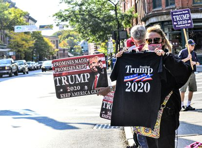 Claire Huntley, of Wilmington, Vermont, and others gather at Pliny Park, in Brattleboro, to show support for President Donald Trump during a rally on Saturday.