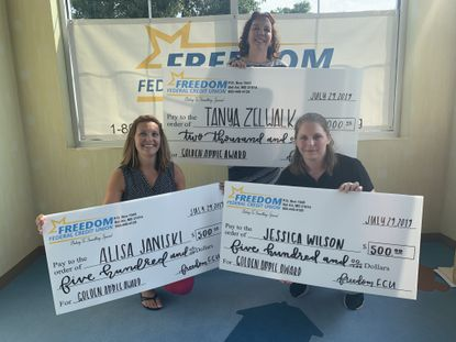 Freedom Federal Credit Union awards grant funds to its 2019 Golden Apple Annual Education Award recipients, from left, Alisa Janiski, Tanya Zelwalk and Jess Wilson.