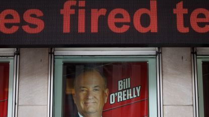Advertisements for Fox News and Bill O'Reilly stand in a window outside of Fox News headquarters in Manhattan in 2017 on the day it was announced that O'Reilly would not be returning to the network following numerous claims of sexual harassment and subsequent legal settlements.
